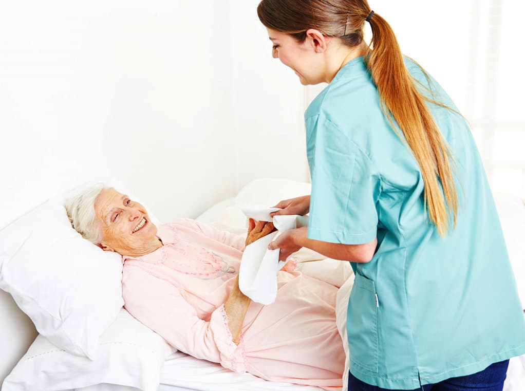portrait of an elder being cared by a woman